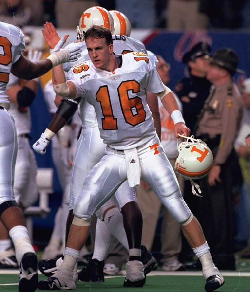 Peyton celebrates a narrow 30-29 victory over Auburn in the 1997 SEC Championship game. (Damian Strohmeyer/SI)