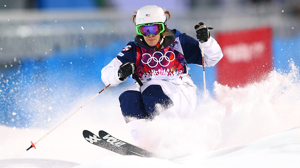 Hannah Kearney takes the lead in the women's moguls competition after the first day of qualifying.