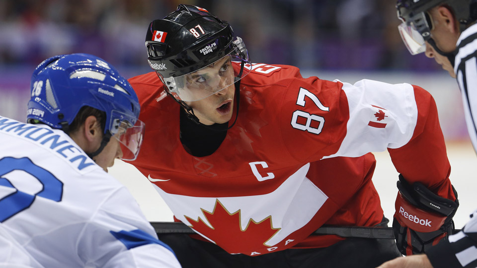 Canada forward Sidney Crosby watches the official during a face-off against Finland forward Jarkko Immonen in the first period of a men's ice hockey game at the 2014 Winter Olympics, Sunday, Feb. 16, 2014, in Sochi, Russia.