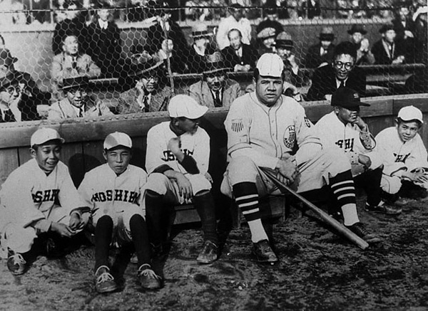 Ruth poses with bat boys during a 1934 barnstorming tour of Japan. (SI Picture Collection)