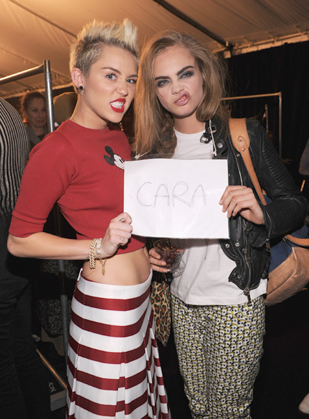 Cara Delevingne and Miley Cyrus :: Getty Images