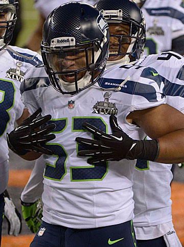 Malcolm Smith and the Seahawks defense :: Stephen Dunn/Getty Images