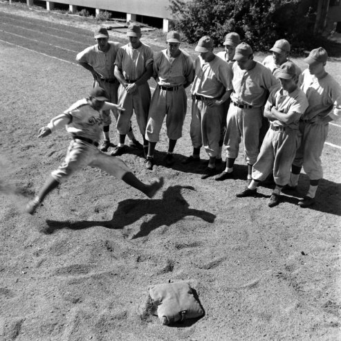 Rookies and prospects practice hook slides. (George Silk—Time & Life Pictures/Getty Images)