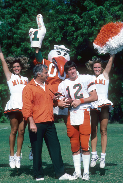 Jim Kelly, Howard Schnellenberger, Sebastian the Ibis  and cheerleaders (1982) :: Heinz Kluetmeier/SI