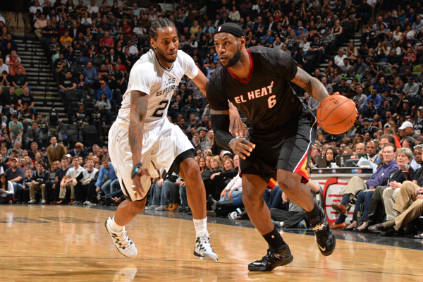 LeBron James (right) wore a black short-sleeve in March. (Jesse D. Garrabrant/Getty Images)