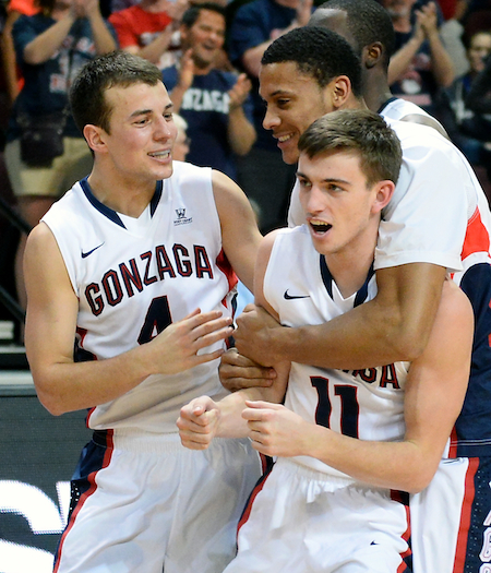 Teammates grab hold of David Stockton after he nets a game winner for the Zags. (Getty Images)