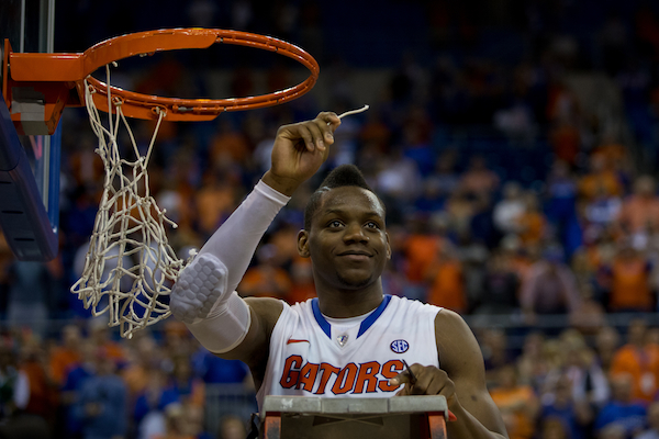 Florida senior Will Yeguete holding up his SEC souvenir. (Photo by Rob Foldy/Getty Images)