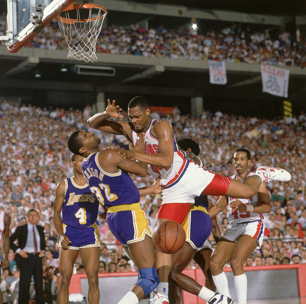 Rick Mahorn and Magic Johnson :: Manny Millan/SI