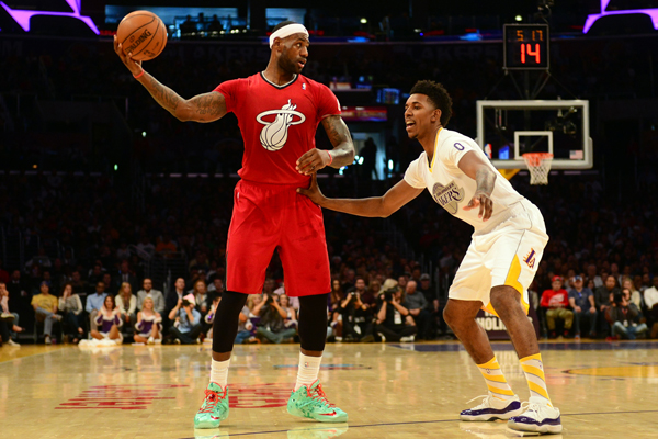 LeBron James wore a bright red short-sleeve jersey on Christmas. (FREDERIC J. BROWN/AFP)