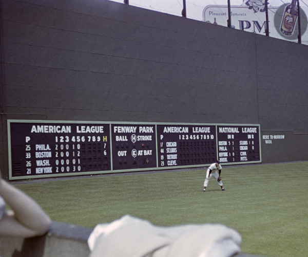 Outfielder Ted Williams #9 of the Boston Red Sox is ready in his position during a game on July 4, 1947 against the Philadelphia A's at Fenway Park in Boston, Massachusetts. (Photo by:  Diamond Images/Getty Images)
