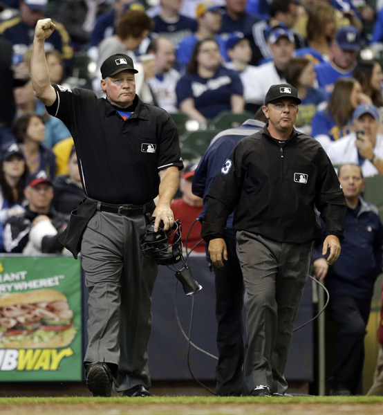 Umpires in the Mets-Brewers overturn the first call under MLB's expanded replay system. (AP Photo/Jeffrey Phelps)