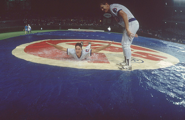 Greg Maddux and Les Lancaster waste some time during a rain delay. (Heinz Kluetmeier/SI)