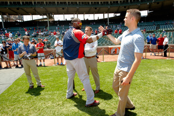 Cubs GM Theo Epstein greets David Ortiz before a 2012 Cubs-Red Sox game. (Stephen Green/SI)