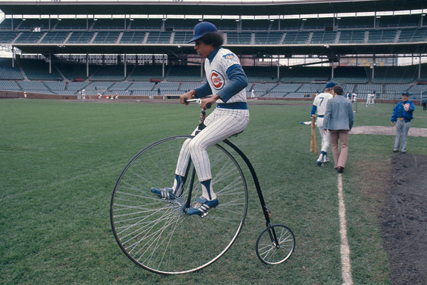 Jose Cardenal rides an antique bike before a 1975 game. (Walter Iooss. Jr/SI)