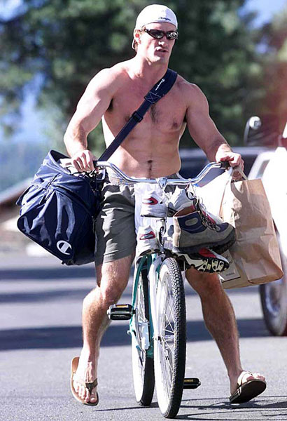 Tillman bikes to his dorm after a 2002 training camp practice. (AP)
