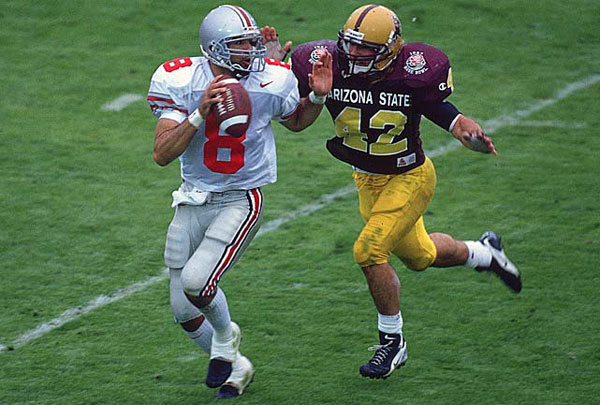 Tillman chases down Stanley Jackson during the Rose Bowl in 1997. (V.J. Lovero/SI)