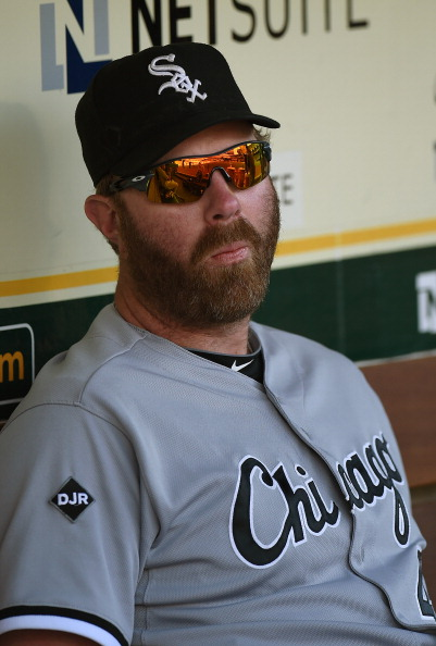 Adam Dunn was sporting a robust beard during the White Sox game against the Athletics. Worth noting: you can see a little regrowth on his face going all the way up to his sunglasses. Is Adam Dunn a wolf man? We'll keep our eyes on it.