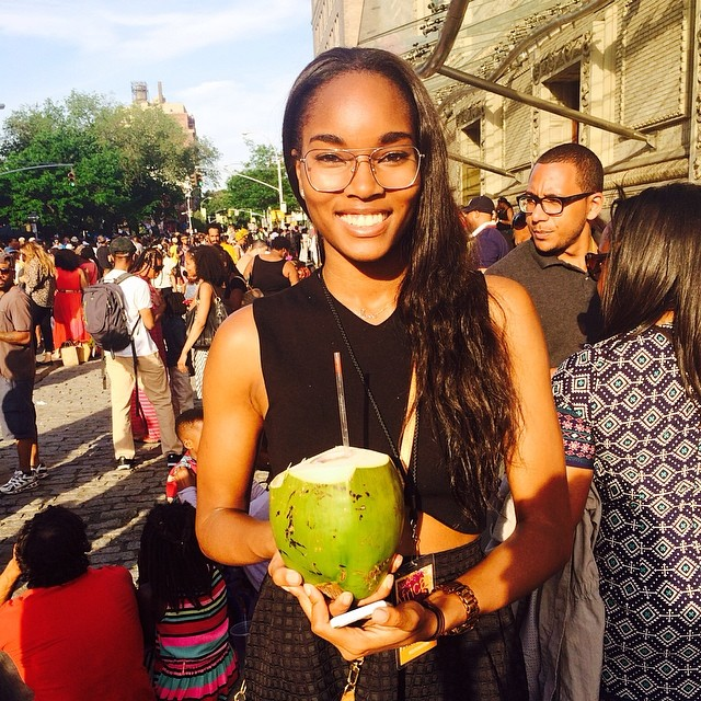 A dancer at her core, Damaris Lewis (@damarislewis) kicks back with a coconut at the DanceAfrica festival in her hometown of Brooklyn