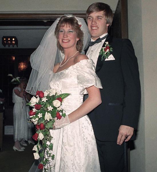 John Elway and Janet Buchan :: AP