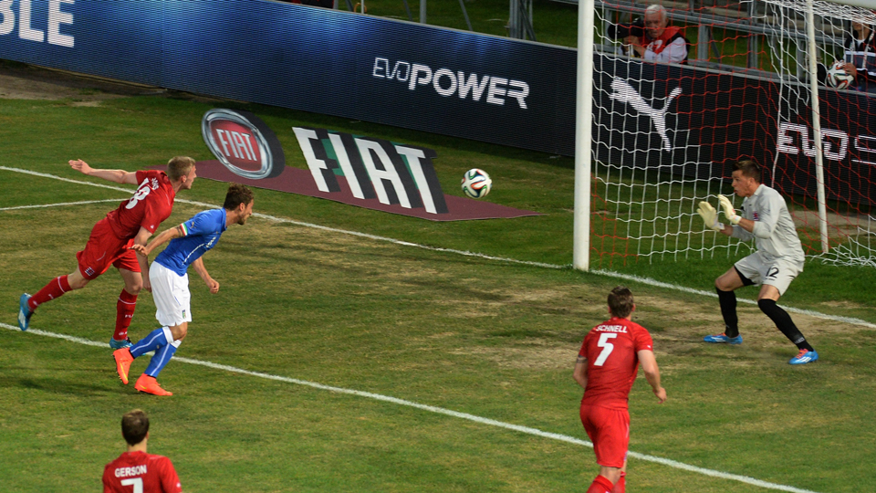 Italy's Claudio Marchisio, second from left, heads home the opening goal in a 1-1 draw with Luxembourg on Wednesday.