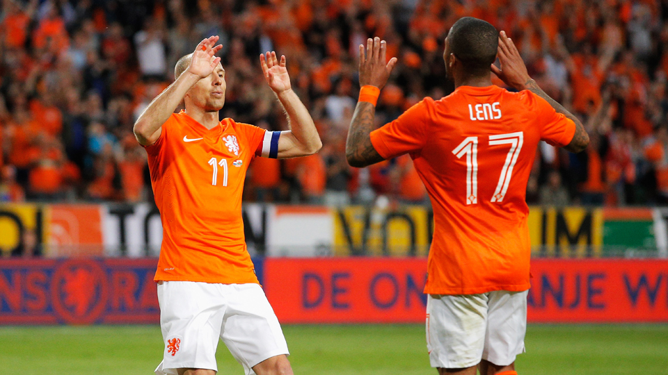 Netherlands goal scorers (from left) Arjen Robben and Jermaine Lens celebrate during Wednesday's 2-0 friendly win over Wales.