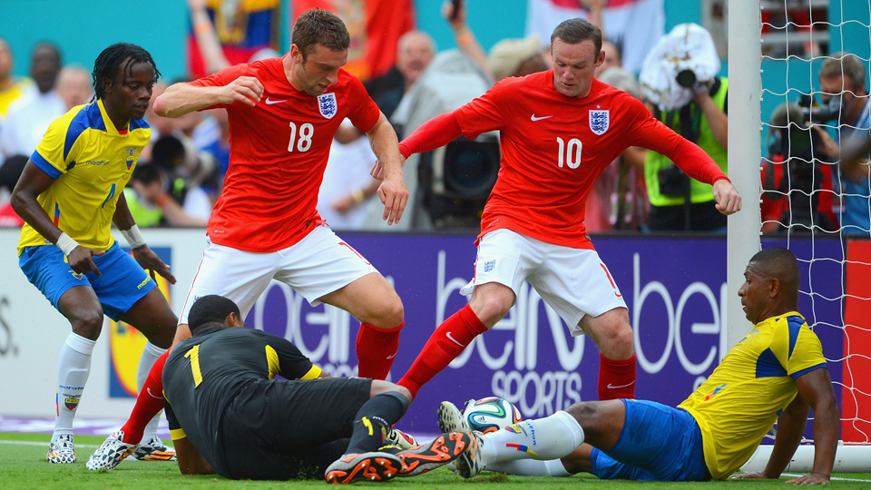 Wayne Rooney (10) scores off a loose ball from close range in England's 2-2 draw with Ecuador on Wednesday.