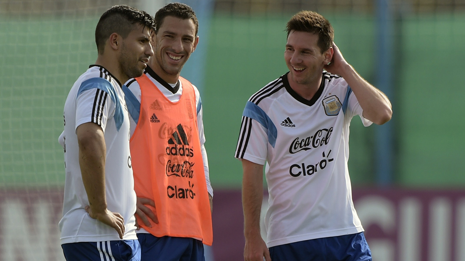 Lionel Messi (right) and his compatriots hope to be all smiles amid expectations of winning a World Cup title.
