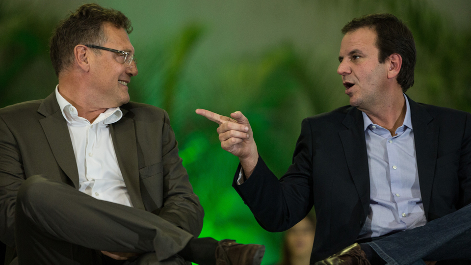 Rio de Janeiro mayor Eduardo Paes, right, sits with FIFA general secretary Jerome Valcke.