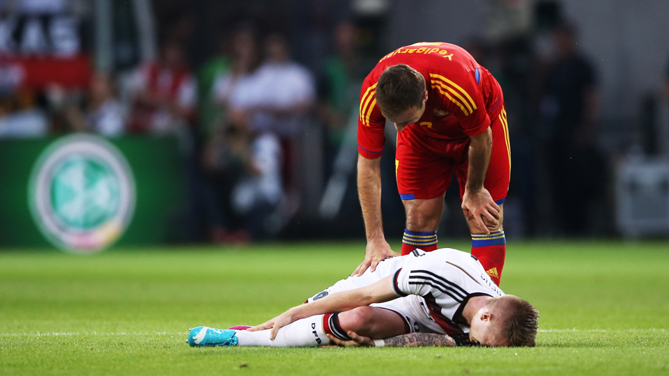 Germany star Marco Reus writhes in pain after injuring his ankle in a friendly against Armenia on Friday.
