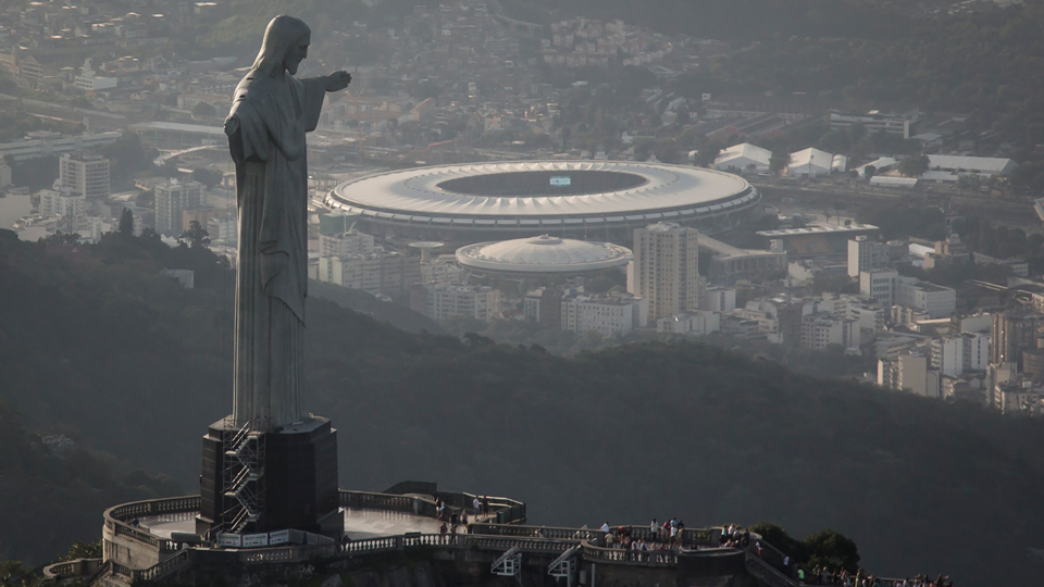 The Christ the Redeemer Statue overlooks the Maracana Stadium in Rio de Janeiro, where the 2014 World Cup champion will be crowned.