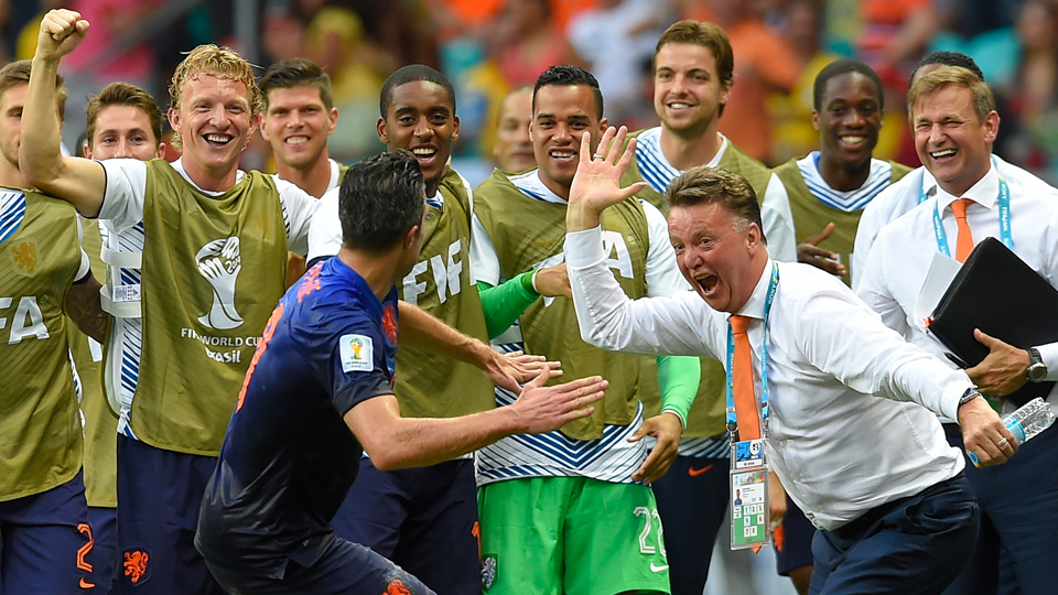 Netherlands manager Louis van Gaal, right, goes in for the high five with Robin van Persie after his highlight-reel header sparked a 5-1 rout of defending World Cup champion Spain in their Group B opener.