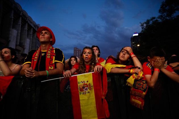 Spain fans in Madrid watch in horror and dismay as their beloved Furia Roja fall 5-1 to the Netherlands.