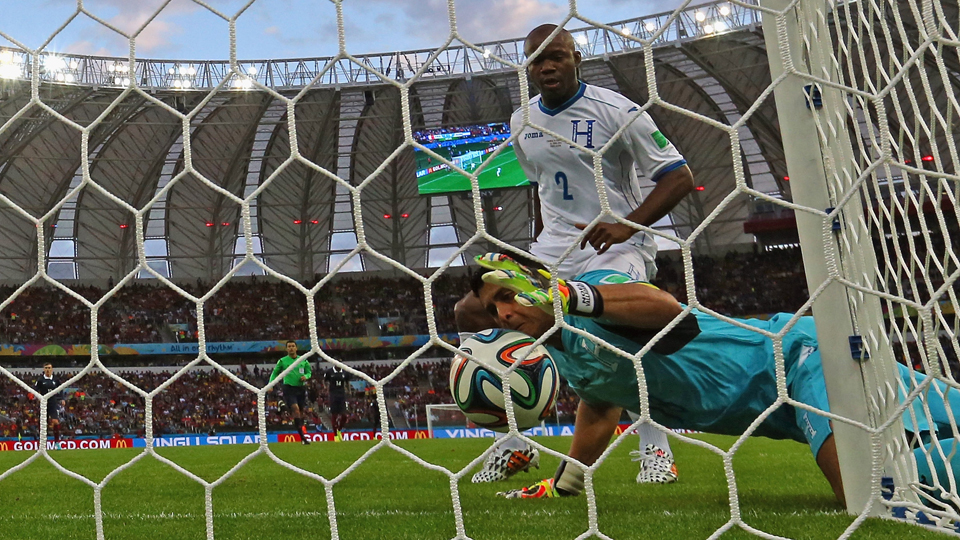 Honduras goalkeeper Noel Valladares tries to keep a ball out of his own net, but goal-line technology confirmed a France goal on the close call.