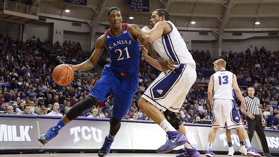 Joel Embiid (left) was dominating for Kansas when he was on the court, but back and leg injuries derailed him late in the year.
