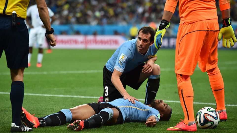 Uruguay's Alvaro Pereira appears to be knocked out after taking a blow to the head from England's Raheem Sterling.