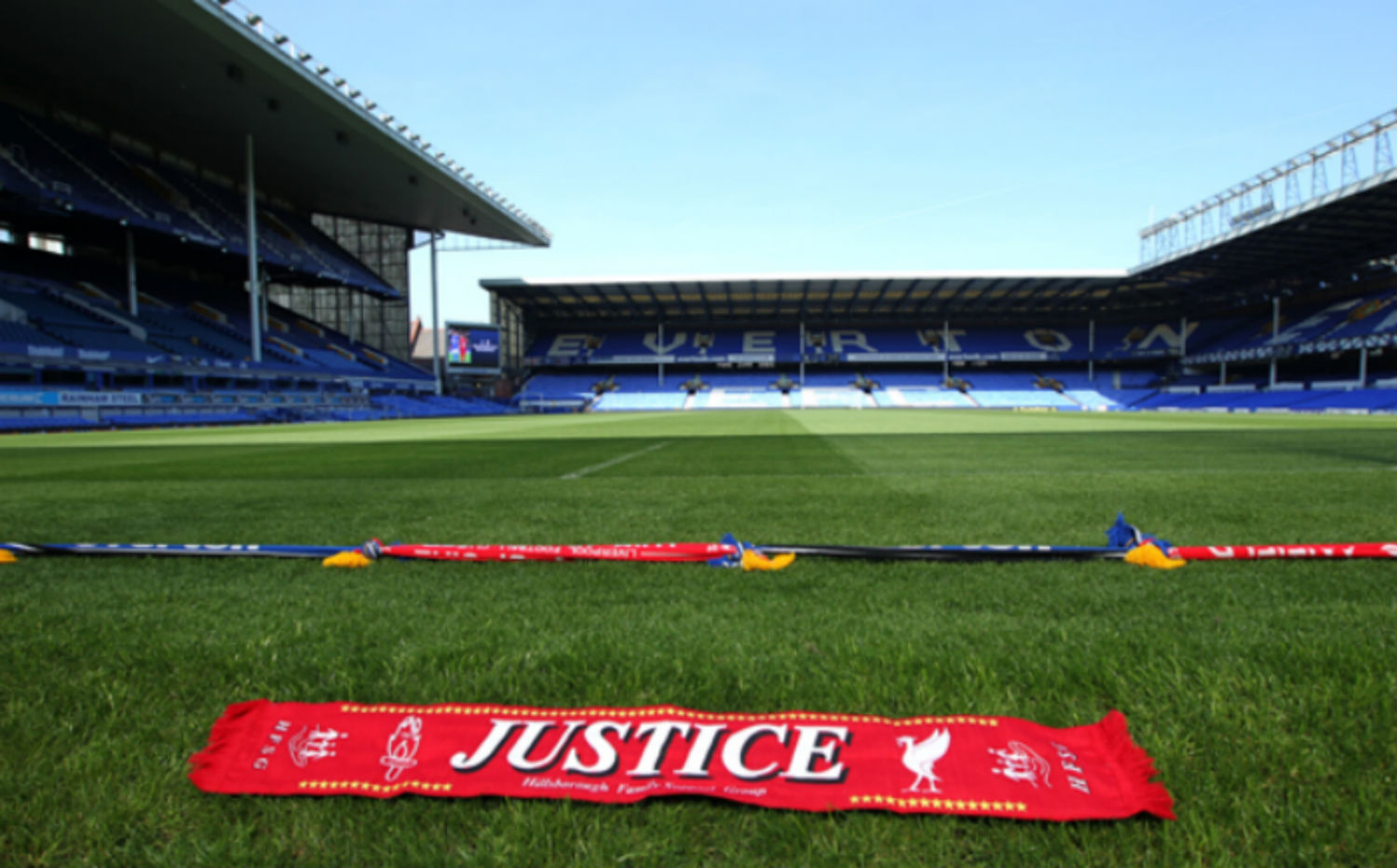 Scarves on the field at Goodison Park symbolize the unity between rivals Everton and Liverpool. (Press Association/AP)
