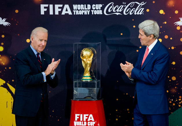U.S. Secretary of State John Kerry, right, and Vice President Joe Biden have a look at the World Cup trophy at a U.S. State Department event in April.