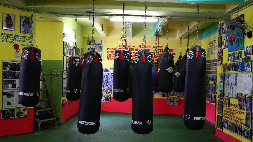Pavao-Pavaozinho is a favela home to a gym where champions come to train. Owner Claudio Coelho now teaches a combination of boxing and jiu-jitsu there.