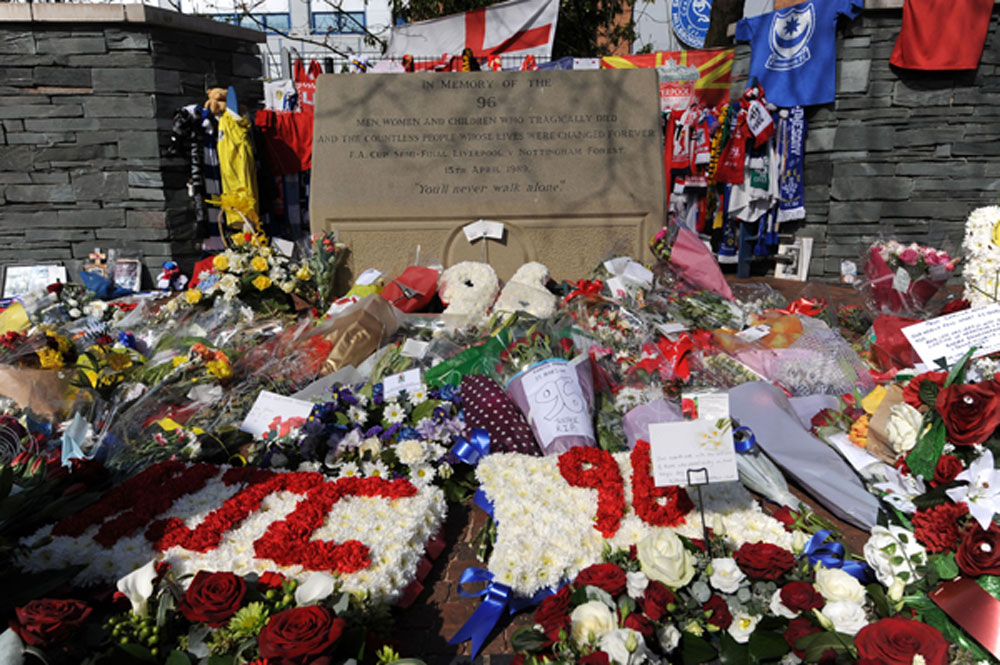 Fans leave flowers and other offerings at Sheffield's Hillsborough Stadium, site of the tragedy. (AP photo)