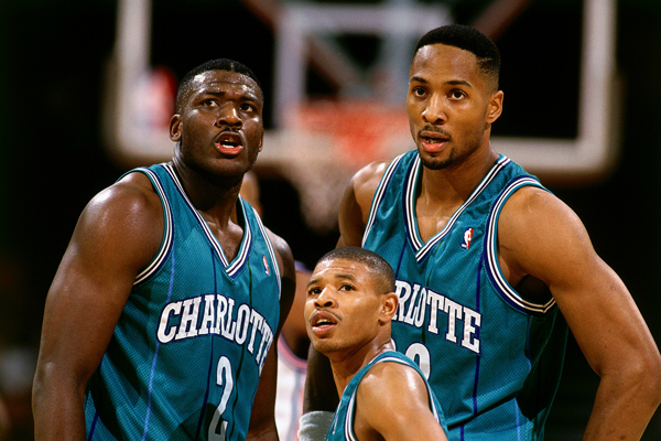 Larry Johnson, Muggsy Bogues and Alonzo Mourning :: Getty Images