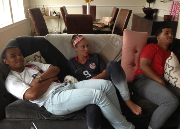Charlie Davies, left, watches the USA-Germany World Cup match with his wife, Nina, and brother, Justin.