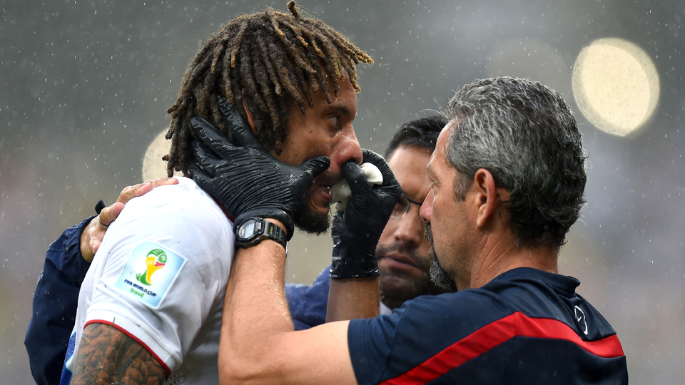 USA midfielder Jermaine Jones gets tended to by trainers after suffering a broken nose in Friday's 1-0 loss to Germany.