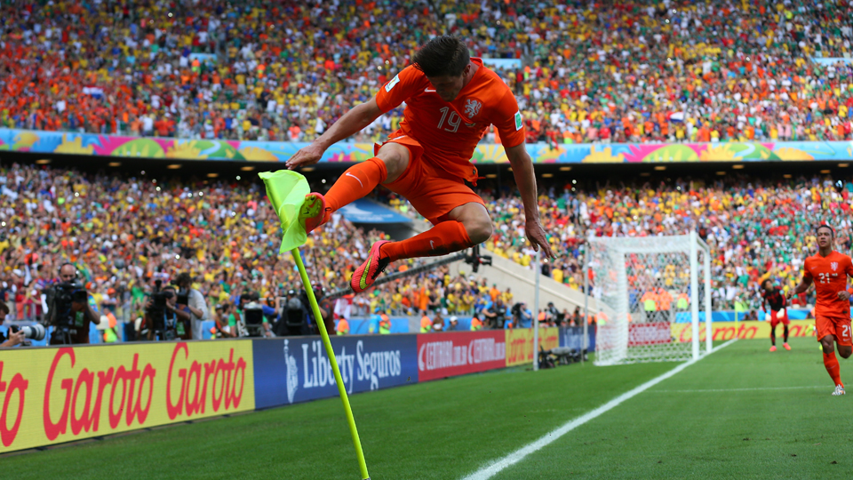 Klaas-Jan Huntelaar celebrates his game-winning penalty kick that put the Netherlands back in the World Cup quarterfinals with a come-from-behind 2-1 victory over Mexico.