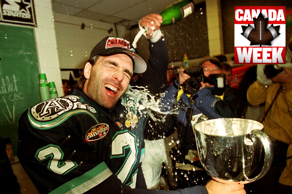 Image result for doug flutie holding Grey cup
