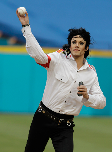 A Jackson look-alike throws the first pitch before a 2010 Marlins-Mets game. (AP)