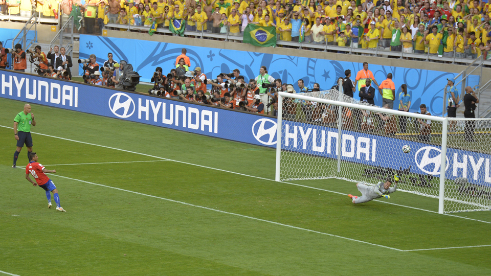 Chile's Gonzalo Jara watches his penalty kick clang off the post in a round of 16 loss to Brazil.
