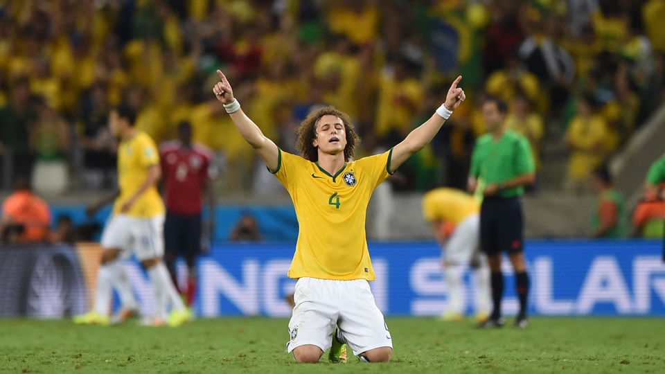 Brazil defender David Luiz points to the heavens after the World Cup host nation secured a 2-1 win over Colombia, advancing to the semifinals against Germany.