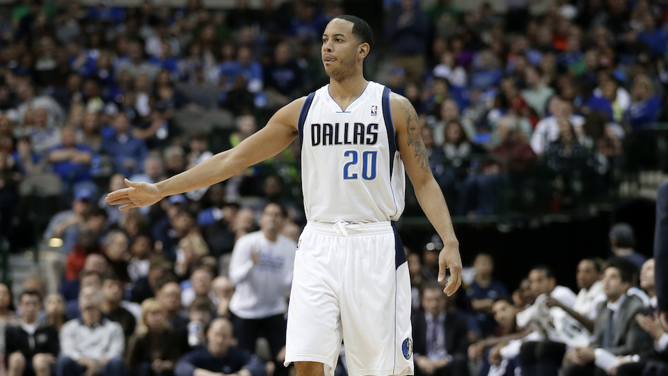Dallas Mavericks Devin Harris walks down the court in a game against the Portland Trail Blazers