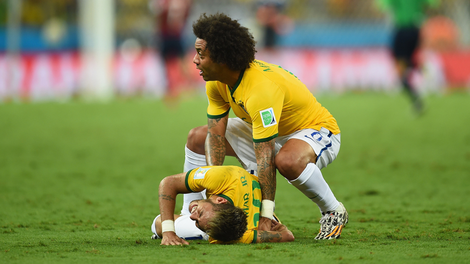 Marcelo, right, checks on Neymar after he suffered a knee to the back from Colombia's Camilo Zuniga that ended his World Cup.