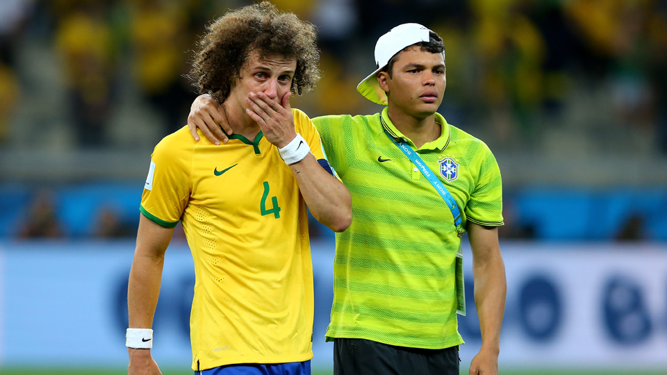Brazil defender David Luiz, left, and suspended defender Thiago Silva walk off the field in shock following a 7-1 loss to Germany in the World Cup semifinals.